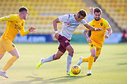 Sean Clare (#8) of Heart of Midlothian FC bursts away from Keaghan Jacobs (#7) of Livingston FC and Jack McMillan (#21) of Livingston FC during the Ladbrokes Scottish Premiership match between Livingston FC and Heart of Midlothian at the Tony Macaroni Arena, Livingston, Scotland on 26 October 2019.