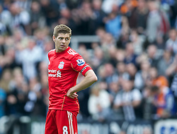NEWCASTLE-UPON-TYNE, ENGLAND - Sunday, April 1, 2012: Liverpool's captain Steven Gerrard looks dejected as Newcastle United score the second goal during the Premiership match at St James' Park. (Pic by David Rawcliffe/Propaganda)