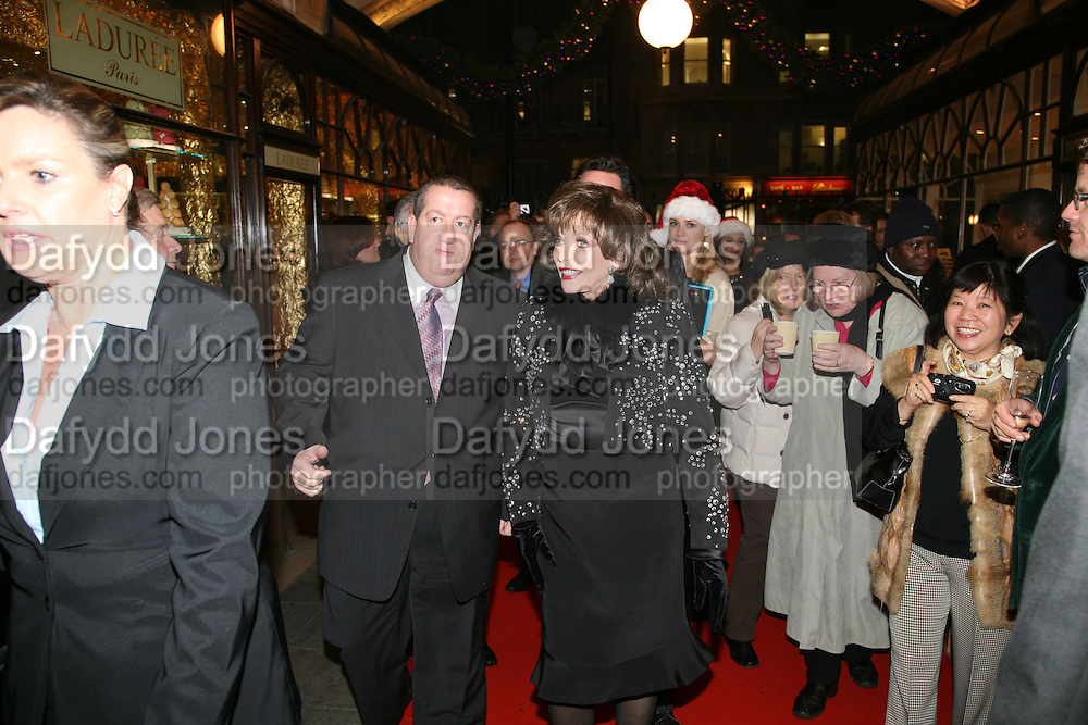 JOAN COLLINS AND LAWRENCE DAVIES,  Joan Collins Turns On Burlington Arcade Christmas Lights, PICCADILLY, LONDON - NOVEMBER 20 2007. -DO NOT ARCHIVE-© Copyright Photograph by Dafydd Jones. 248 Clapham Rd. London SW9 0PZ. Tel 0207 820 0771. www.dafjones.com.
