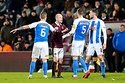 Steven Naismith (#14) of Heart of Midlothian engages in discussion with Alan Power (#6) of Kilmarnock and Kirk Broadfoot (#5) of Kilmarnock following a foul by Stephen O'Donnell (#2) of Kilmarnock on Danny Amankwaa (#7) of Heart of Midlothian during the Ladbrokes Scottish Premiership match between Heart of Midlothian and Kilmarnock at Tynecastle Stadium, Gorgie, Scotland on 27 February 2018. Picture by Craig Doyle.
