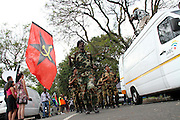 Umkhonto we Sizwe soldiers marching towards former president Nelson Mandela Houghton home, Johannesburg. Scores of people were brought flowers an lit candles in memory of the fallen hero. Mandela died on the December 5 in his Houghton home.<br /> ©Exclusivepix
