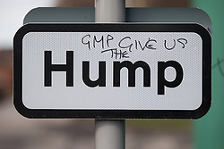"© Licensed to London News Pictures . 21/03/2014 . Preston , UK . A street sign on Barton Moss Road adjacent to the protest camp on which someone has written "" GMP give us the "" before the printed word "" Hump "" . The Barton Moss anti-fracking demonstration camp today (Friday 21st March 2014) . Photo credit : Joel Goodman/LNP"