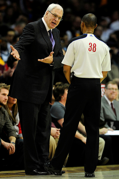 Feb. 16, 2011; Cleveland, OH, USA; Los Angeles Lakers head coach Phil Jackson argues with referee Michael Smith (38) during the fourth quarter against the Cleveland Cavaliers at Quicken Loans Arena. The Cavaliers beat the Lakers 104-99. Mandatory Credit: Jason Miller-US PRESSWIRE