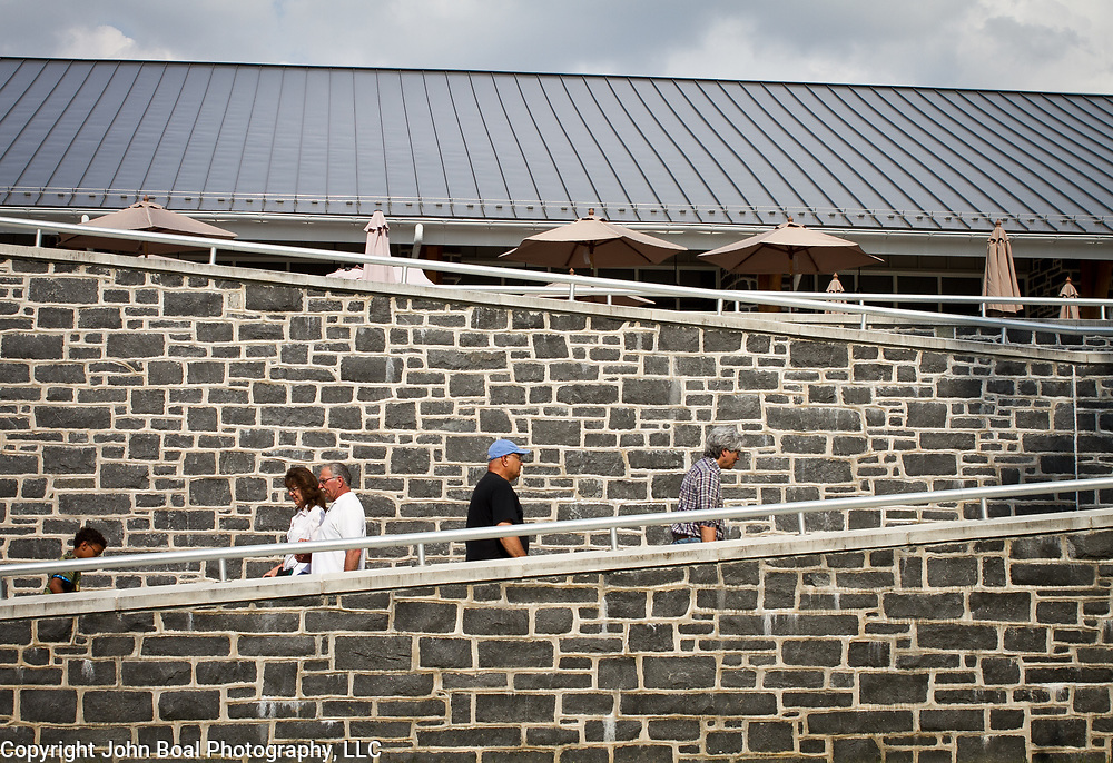 Visitors make the climb up the ramp to the Gettysburg National Military Park Visitors Center, during the Sesquicentennial Anniversary of the Battle of Gettysburg, Pennsylvania on Sunday, June 30, 2013.  A pivotal battle in the Civil War, over 50,000 soldiers died in the battle which spanned 3 days from July 1-3, 1863.  Later that year, President Abraham Lincoln returned to Gettysburg to deliver his now famous Gettysburg Address to dedicate the cemetery there for the Union soldiers who died in battle.  John Boal photography