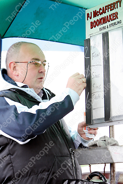 A bookie marks his odds at the Lisdoonvarna races over the weekend.<br />