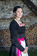 Johanna is wearing a Traditional Bridal Costume in Bad Failnbach, Bavaria in Germany on August 1st, 2017.<br /> <br /> Johanna is wearing a dress from the Degerndorf/Inntal area with a so called 'Kasettl'.<br /> <br /> Women wear these dresses not only to their wedding, but also to ecclestical celebrations and holidays or other weddings.