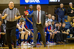Jan 12, 2016; Morgantown, WV, USA; Kansas Jayhawks head coach Bill Self yells from the bench during the first half against the West Virginia Mountaineers at the WVU Coliseum. Mandatory Credit: Ben Queen-USA TODAY Sports