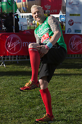 © Licensed to London News Pictures. 21/04/2013. London, England. Picture: Iwan Thomas MBE wearing Red 4 Boston socks. Celebrity Runners at a photocall before the start of the Virgin London Marathon 2013 race. Many wore black ribbons to pay their respect for those who died or were injured in the Boston Marathon. Photo credit: Bettina Strenske/LNP