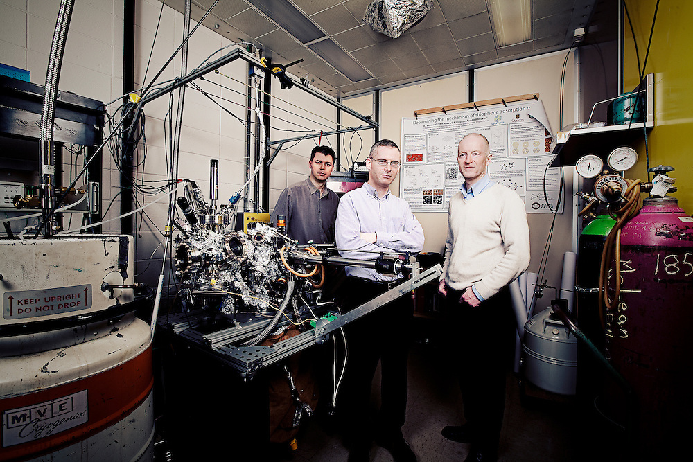 l-r James Stotz, Stephen Hughs, Alastair McLean in nanophysics lab beside a nanophysics microscope