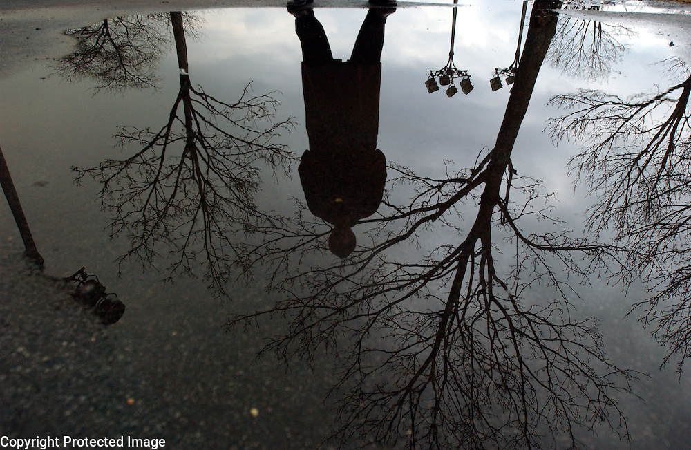 Author Phillip Lopate is seen reflected in a puddle by the George Washington Bridge in Manhattan, NY. 3/9/2004 Photo by Jennifer S. Altman