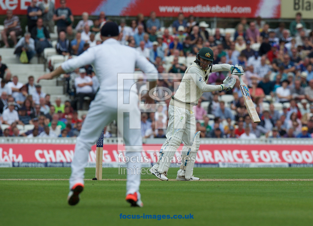 Captain Michael Clarke of Australia looks back to see Joe Root of England catch his shot during the 5th Investec Ashes Test Match match at the Kia Oval, London<br /> Picture by Alan Stanford/Focus Images Ltd +44 7915 056117<br /> 20/08/2015