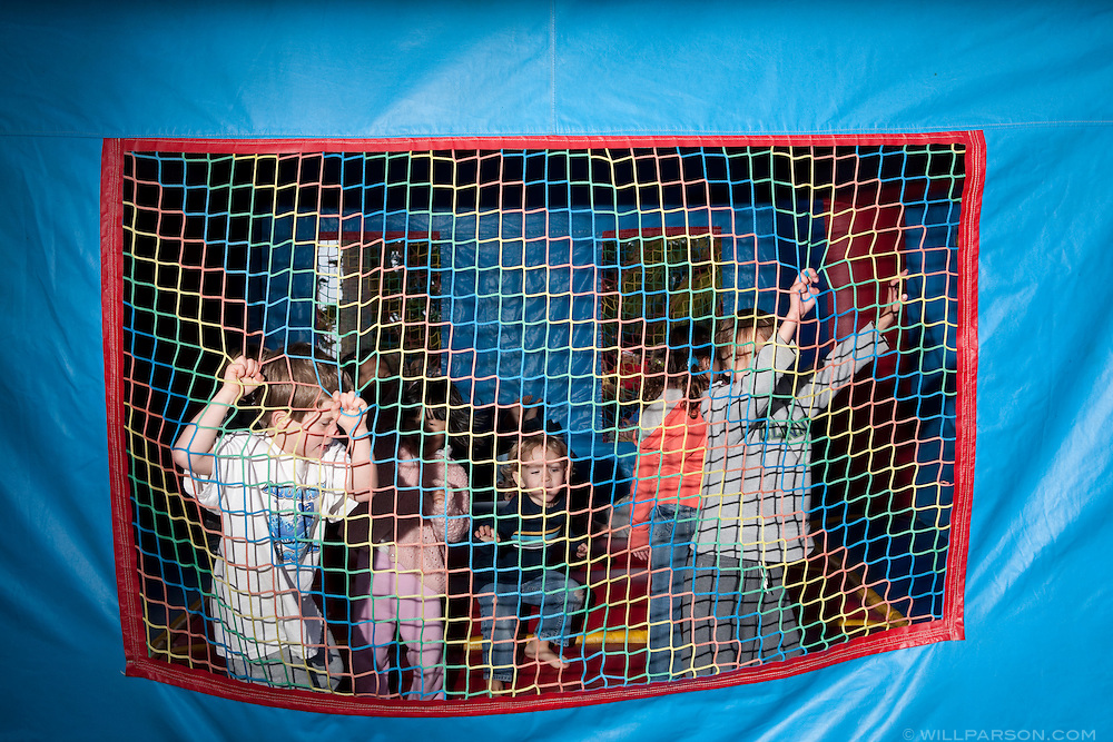 Children play in a bounce house after the 2009 La Jolla Christmas Parade.