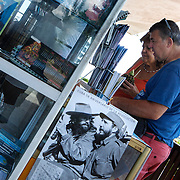 A calendar with pictures of Fidel Castro and Camilo Cienfuegos at the tourist store at the Bacunayagua Bridge over the Yumuri Valley on the Via Blanca highway in the province of Matanzas. Photography by Jose More