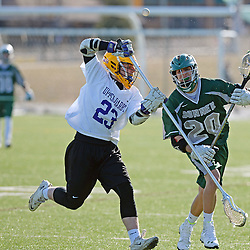 Staff photos by Tom Kelly IV<br /> Bonner-Prendie's Nick Accardo (20) has the ball stripped from him by Upper Darby's James O'Hara (23) and at least one foul was called on the play, during the Upper Darby at Bonner-Prendie boys lacrosse game on Monday, March 23, 2015.