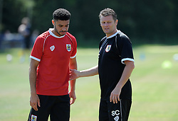 - Photo mandatory by-line: Dan Rowley/JMP - Tel: Mobile: 07966 386802 24/07/2013 - SPORT - FOOTBALL - Bristol -  Bristol City V Reading<br /> Bristol City manager talks to defender Derrick Williams during their first pre-season training session.