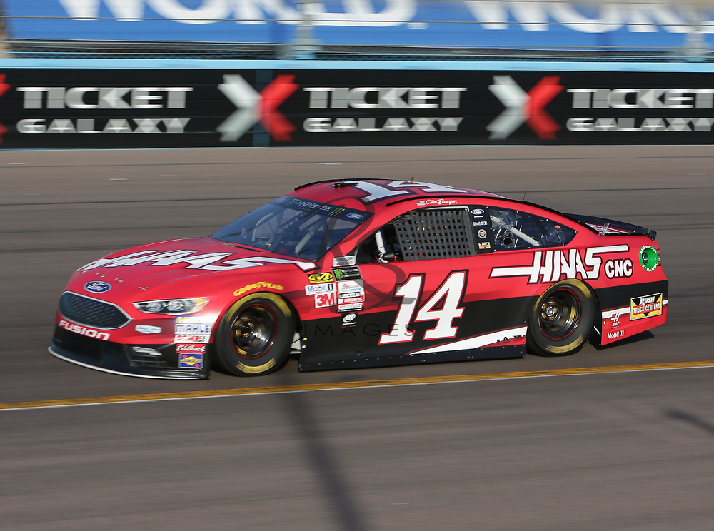 Clint Bowyer qualifies for Sunday's NASCAR Cup Series auto race on Friday, March 17, 2017, in Avondale, Ariz.  (AP Photo/Rick Scuteri)