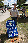 Candice Fitzgerald with her newly constructed bean bag toss game at 2016 Water Festival in Abita Springs Park