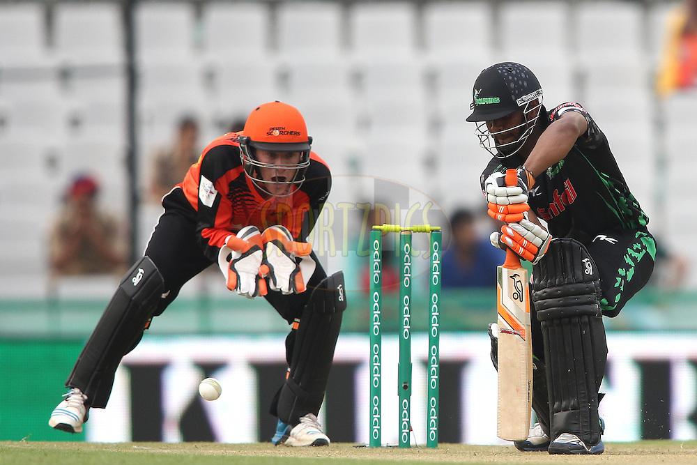 Khayelihle Zondo of the Dolphins plays a delivery square during match 4 of the Oppo Champions League Twenty20 between the Dolphins and the Perth Scorchers held at the Punjab Cricket Association Stadium, Mohali, India on the 20th September 2014<br /> <br /> Photo by:  Shaun Roy / Sportzpics/ CLT20<br /> <br /> <br /> Image use is subject to the terms and conditions as laid out by the BCCI/ CLT20.  The terms and conditions can be downloaded here:<br /> <br /> http://sportzpics.photoshelter.com/gallery/CLT20-Image-Terms-and-Conditions-2014/G0000IfNJn535VPU/C0000QhhKadWcjYs