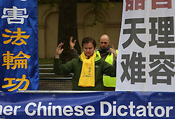 © Licensed to London News Pictures. 20/10/2015. London, UK. A Falung Dafa protestors stands in The Mall ahead of Chinese President Xi Jinping's four day State Visit to the United Kingdom. Photo credit: Peter Macdiarmid/LNP