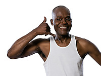 Portrait of a friendly afro American man showing call me gesture in studio on white isolated background