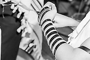 Bar Mitzvah ceremony A young boy of 13 laying Tefillin. Close up of the hands and arms
