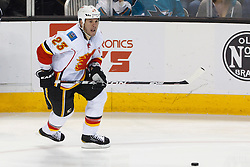 Feb 8, 2012; San Jose, CA, USA; Calgary Flames defenseman Scott Hannan (23) skates with the puck against the San Jose Sharks during the first period at HP Pavilion. Calgary defeated San Jose 4-3. Mandatory Credit: Jason O. Watson-US PRESSWIRE