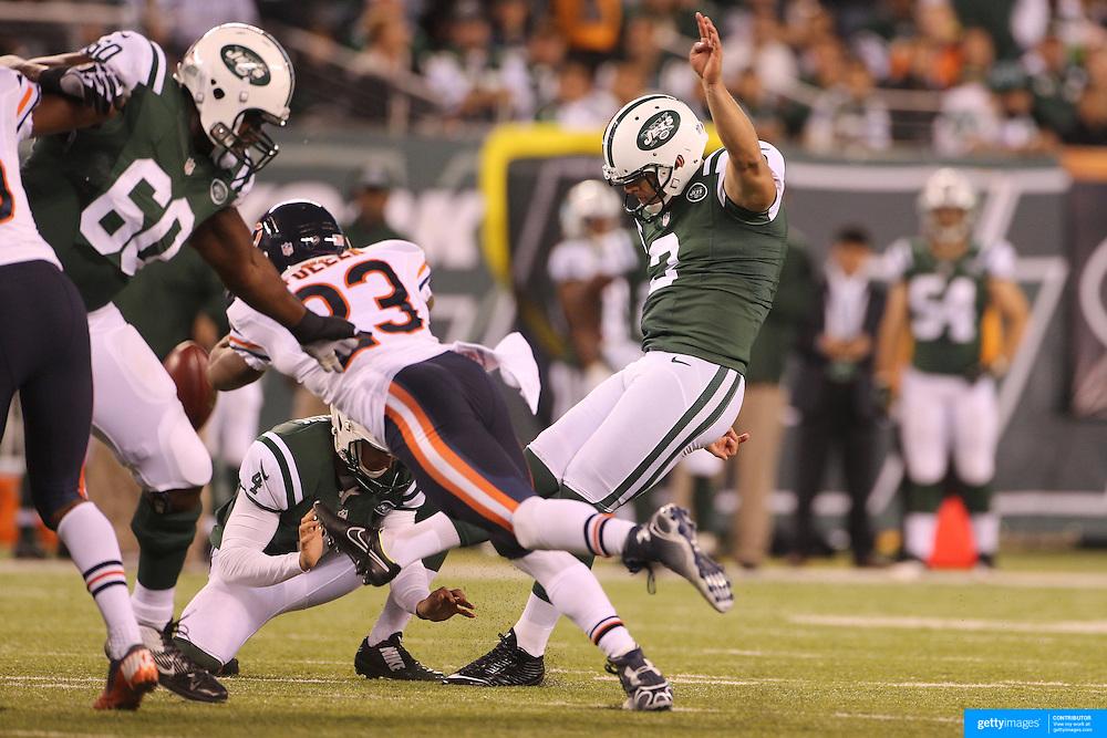 Nick Folk, New York Jets, kicks a field goal during the New York Jets Vs Chicago Bears, NFL regular season game at MetLife Stadium, East Rutherford, NJ, USA. 22nd September 2014. Photo Tim Clayton for the New York Times