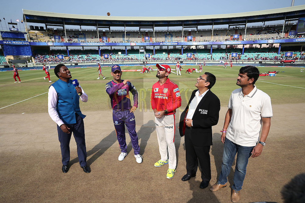 Rising Pune Supergiants captain MS Dhoni tosses the coin as Kings XI Punjab captain Murali Vijay call and Match Referee Ranjan Madugalle looks on during match 53 of the Vivo IPL 2016 (Indian Premier League) between Rising Pune Supergiants and the Kings XI Punjab held at the ACA-VDCA Stadium, Visakhapatnam on the 21st May 2016<br /> <br /> Photo by Shaun Roy / IPL/ SPORTZPICS