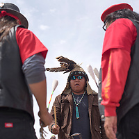 040415      Cayla Nimmo<br /> <br /> Kris Barney and members of the American Indian Movement sing and drum before the demonstration held at the Gallup Chamber of Commerce Saturday. Protestors marched down Route 66 carrying signs calling for an end to racism against native people in Gallup.