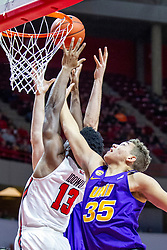 NORMAL, IL - December 31: Rey Idowu and Noah Carter reach for a loose ball during a college basketball game between the ISU Redbirds and the University of Northern Iowa Panthers on December 31 2019 at Redbird Arena in Normal, IL. (Photo by Alan Look)