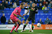 James Norwood of Tranmere Rovers watches as Forest Green Rovers goalkeeper Lewis Ward(34) gathers a header during the EFL Sky Bet League 2 play off first leg match between Tranmere Rovers and Forest Green Rovers at Prenton Park, Birkenhead, England on 10 May 2019.