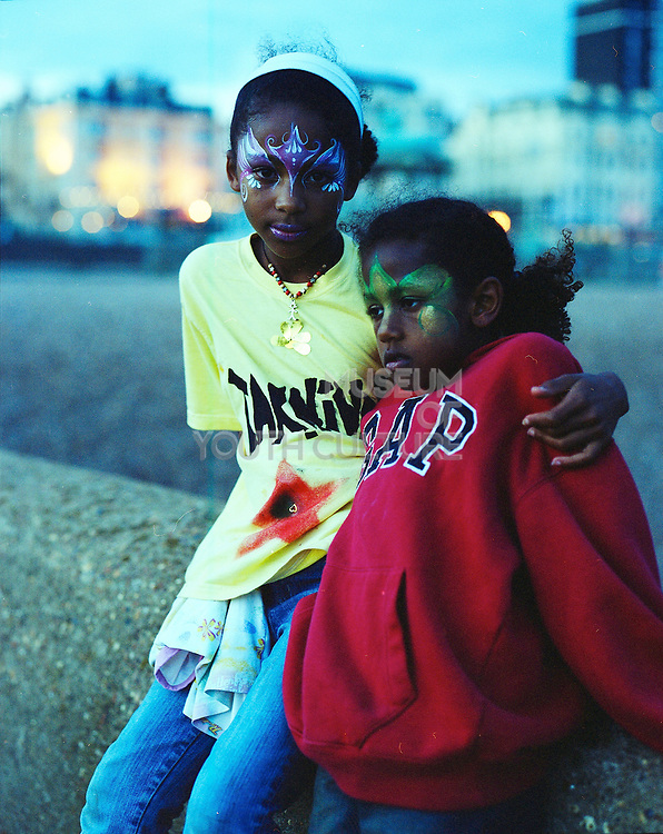 Angie's kids with face paints in Brighton, UK, 1990s.