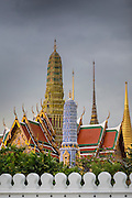 05 MAY 2013 - BANGKOK, THAILAND:  Clouds gather over the spires of temples on the grounds of the Grand Palace during an unseasonal thunderstorm near the Grand Palace in Bangkok, Thailand. The rainy season in Bangkok is usually mid June through early November, but 2013 has seen unseasonal rains through what is normally Bangkok's dry season.       PHOTO BY JACK KURTZ