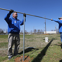 Andy Loden, left, and Gary McKissick begin repairing several outfield fences around the softball fields at Wesson Park in Saltillo Tuesday.