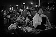 Residents in the provincial city of Chengdu are abondonding their homes for the evening in fear of press reporting of imminent aftershocks in the province of Sichuan. Many are sleeping with their families in cars, buses and tents pitched in the citys public parks. Some are pitched on the pavements away from multistory buildings.