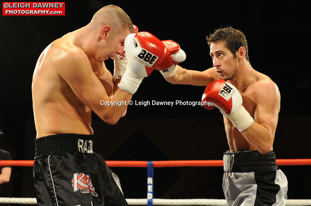 Steve Jennings (black/grey shorts) defeats George Watson at Rainton Meadows Arena, Sunderland, 11th September 2010. Frank Maloney Promotions. © Photo credit: Leigh Dawney
