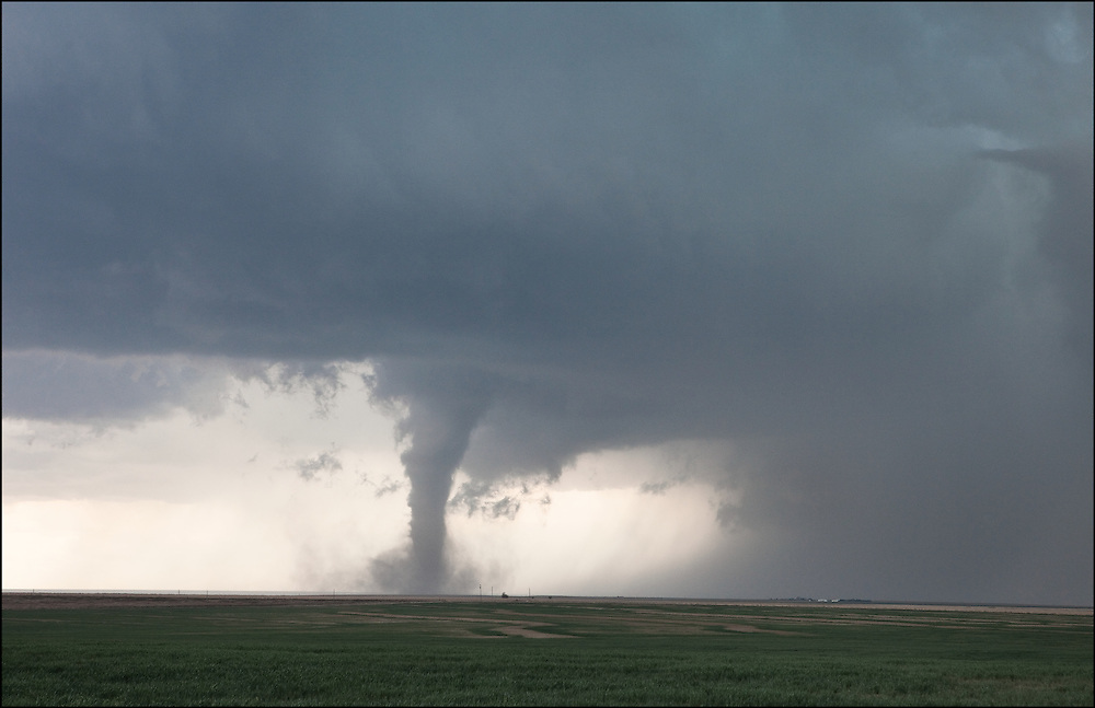 Fully condensed tornado in an open field near Eads, Colorado.