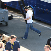 Sprint Cup Series driver Dale Earnhardt Jr. (88) sneaks away from fans and the media after the drivers meeting at Daytona International Speedway on February 20, 2011 in Daytona Beach, Florida. (AP Photo/Alex Menendez)