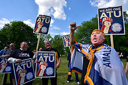 Members of the Amalgamated Transit Union NJ State Council joined protesters outside as presumptive GOP nominee Donald Trump attends a fundraising event with NJ Gov. Chris Christie at Lawrenceville National Guard Armory in Lawrence Township, NJ