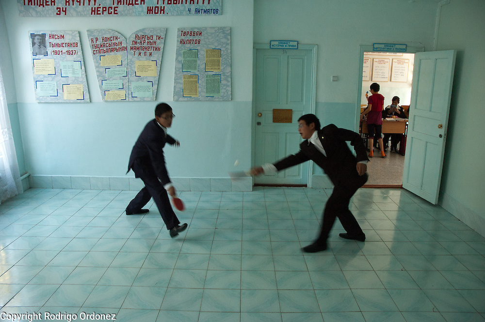 Two boys improvise a ping-pong game outside their classroom at Secondary School for the Blind, in Osh (Kyrgyzstan). Save the Children opened a child-friendly space at this boarding school, where children with and without impaired vision study together.