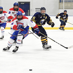 TORONTO, ON  - JAN 7,  2018: Ontario Junior Hockey League game between the Toronto Jr. Canadiens and the Buffalo Jr. Sabres, Chase Spencer #55 of the Toronto Jr. Canadiens and Anthony Hora #81 of the Buffalo Jr. Sabres pursue the play during the second period.<br /> (Photo by Andy Corneau / OJHL Images)