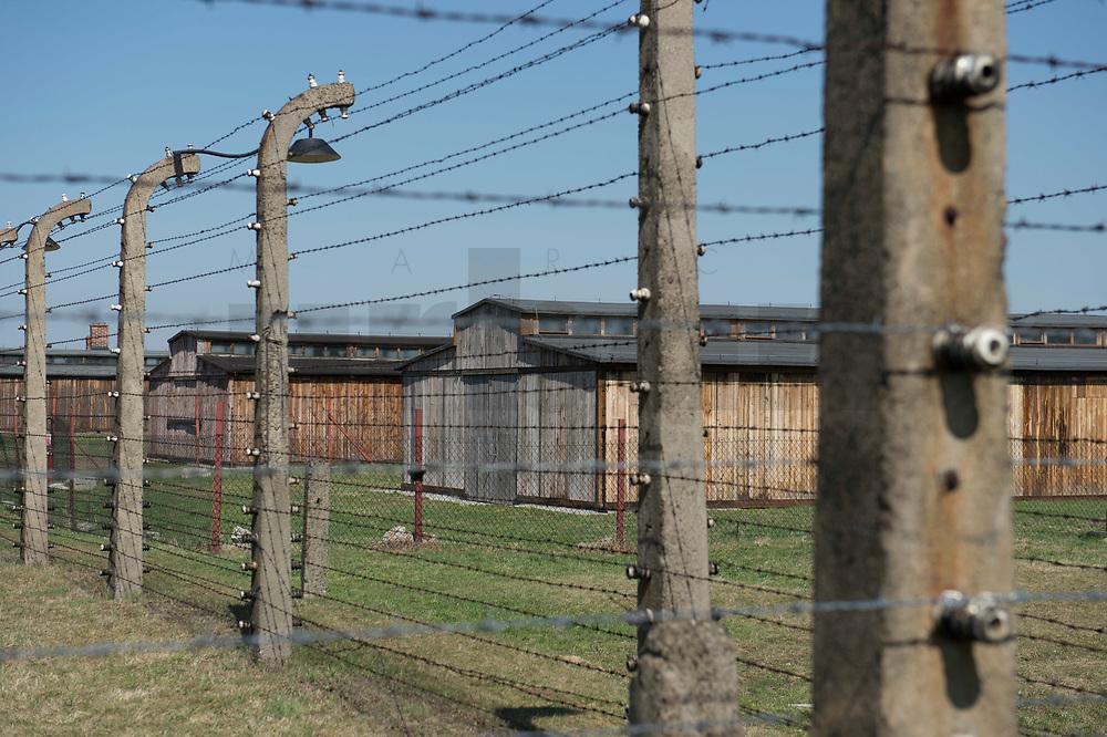09 APR 2012, KRAKOW/POLAND:<br /> Blick durch Stacheldrahtzaun innerhalb des Lagers auf restaurierte Holz-Baraken, Staatliches polnisches Museum / Gedenkstaette des ehem. Konzentrationslager Ausschitz-Birkenau<br /> IMAGE: 20120409-01-013<br /> KEYWORDS: Krakau, KZ, Vernichtungslager Auschwitz II–Birkenau, Polen