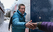 Republican presidential candidate Gov. John Kasich, R-Ohio, shakes one last hand as he heads into his bus after making a stop at the Walt Morse Sporting Good Store in Hillsboro,  N.H. Tuesday, Jan. 19, 2016.  CREDIT: Cheryl Senter for The New York Times
