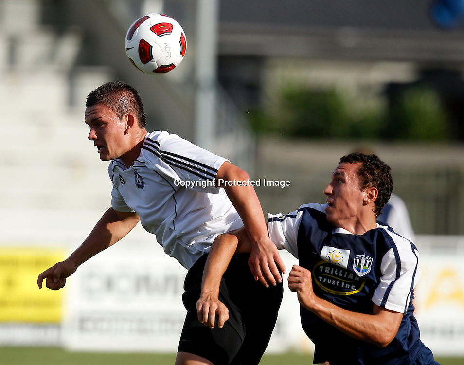 Phoenix's Zane Sole gets a nudge in the back from Auckland's Angel Berlanga. ASB Challenge Series, Auckland City FC v Wellington Phoenix A, Kiwitea Street Auckland, Wednesday 26th January 2011. Photo: Shane Wenzlick