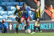 Hakeeb Adelakun of Scunthorpe United under attack from Burton Albion midfielder on loan from Birmingham City Mark Duffy (21)  during the Sky Bet League 1 match between Scunthorpe United and Burton Albion at Glanford Park, Scunthorpe, England on 9 April 2016. Photo by Ian Lyall.