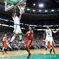 17 November 2012: Boston Celtics power forward Chris Wilcox (44) dunks on a alley-oop pass by Boston Celtics point guard Rajon Rondo (9) during the Boston Celtics 107-89 victory over the Toronto Raptors at the TD Garden, Boston, Massachusetts, USA.