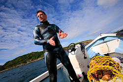UK ENGLAND CORNWALL FALMOUTH 11JUN08 - Dave Thomasson (37) of Bodmin, Cornwall dons a wetsuit and scuba gear as he dives for Scallops in Falmouth Bay. The bay around Falmouth is a special area of conservation for Maerl beds and rich picking ground for Scallops...jre/Photo by Jiri Rezac / WWF UK..© Jiri Rezac 2008..Contact: +44 (0) 7050 110 417.Mobile:  +44 (0) 7801 337 683.Office:  +44 (0) 20 8968 9635..Email:   jiri@jirirezac.com.Web:    www.jirirezac.com..© All images Jiri Rezac 2008 - All rights reserved.
