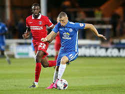 Marcus Maddison of Peterborough United in action with El-Hajdi Ba of Charlton Athletic - Mandatory byline: Joe Dent/JMP - 07966386802 - 25/08/2015 - FOOTBALL - ABAX Stadium -Peterborough,England - Peterborough United v Charlton Athletic - Capital One Cup - Second Round