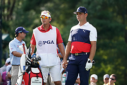 August 9, 2018 - St. Louis, Missouri, United States - Gary Woodland (R) and his caddie Brennan Little wait on the tee during the first round of the 100th PGA Championship at Bellerive Country Club. (Credit Image: © Debby Wong via ZUMA Wire)