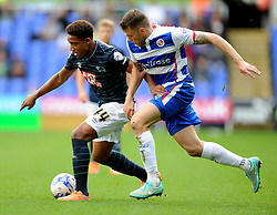 Derby County's Jordan Ibe holds the ball off from Reading's Jamie Mackie - Photo mandatory by-line: Alex James/JMP - Mobile: 07966 386802 - 18/10/2014 - SPORT - Football - Reading - Madejski Stadium - Reading v Derby County - Sky Bet Championship